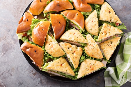 Tray of turkey and ham sandwiches Stock Photo