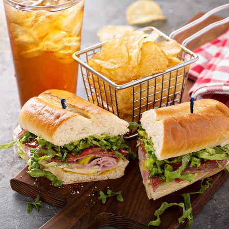 Italian sub sandwich with chips 스톡 콘텐츠