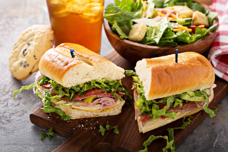Italian sub sandwich with chips Foto de archivo
