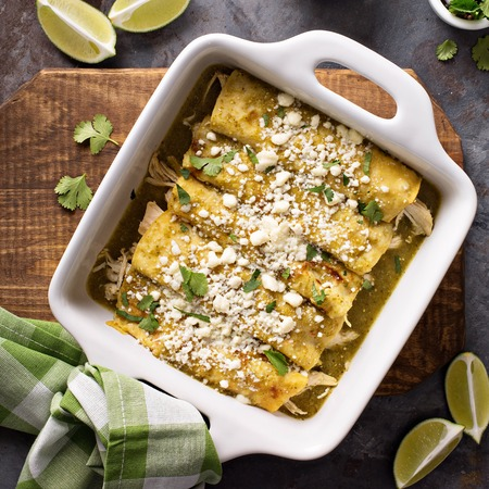 Chicken enchiladas in a casserole dish