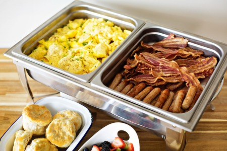 Breakfast buffet with scrambled eggs and bacon