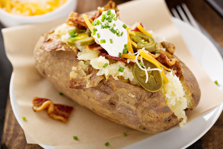 Loaded baked potato with bacon and cheese