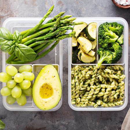 Vegan meal prep containers with pasta and vegetables