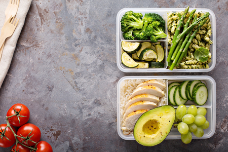 Green and healthy meal prep containers with chicken and vegetables