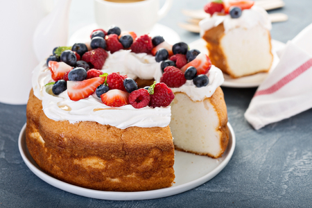 Angel food cake with cream and berries
