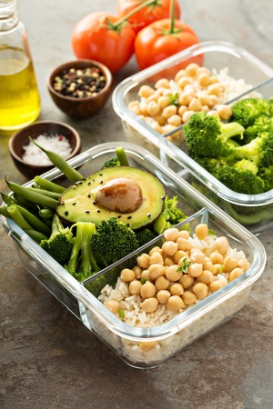 Vegan meal prep containers with cooked rice and chickpeas Archivio Fotografico - 101109183