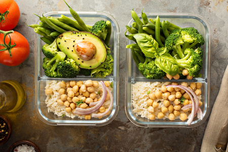 Vegan meal prep containers with cooked rice and chickpeas Stock Photo