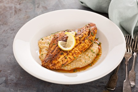 Grits with fried fish