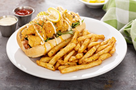 Shrimp po boy sandwich with fries 写真素材