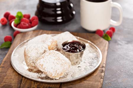 Beignets with raspberry jam Фото со стока