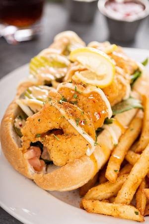 Shrimp po boy sandwich with fries 写真素材