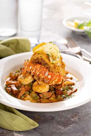 Grits with a lobster tail, shrimp and sausage Stock Photo