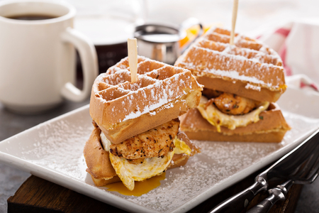 Waffle, fried egg and fish sandwich