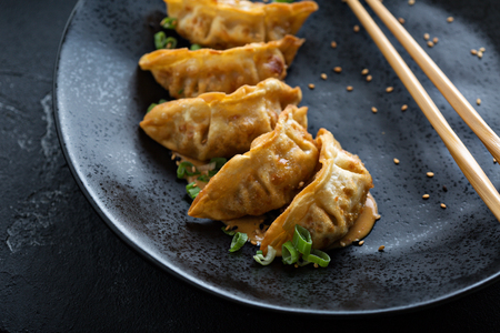 Fried potstickers with green onions Stock Photo