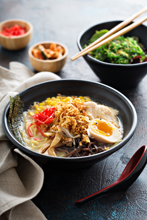 Spicy ramen bowl with noodles and chicken 写真素材