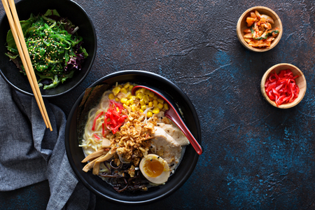 Spicy ramen bowls with noodles, pork and chicken Stockfoto - 101740844