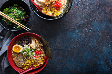Spicy ramen bowls with noodles, pork and chicken
