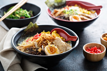Spicy ramen bowls with noodles, pork and chicken Stockfoto - 101740856