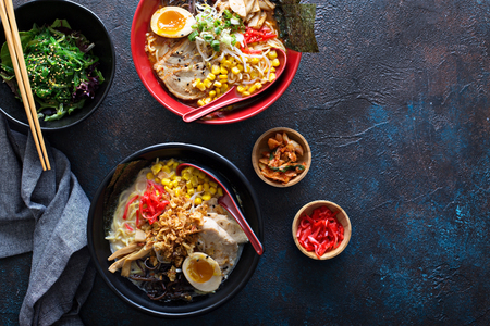 Spicy ramen bowls with noodles, pork and chicken Stockfoto - 101740878
