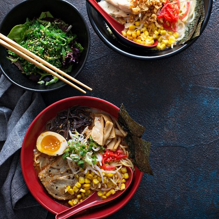 Spicy ramen bowls with noodles, pork and chicken Stockfoto - 101741049