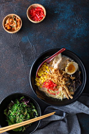 Spicy ramen bowls with noodles, pork and chicken Stockfoto - 101741056