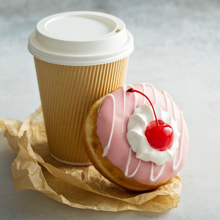 Pink glazed donut with cherry
