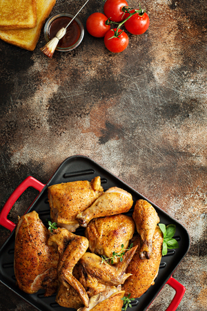 Grilled chicken in a pan Stock Photo