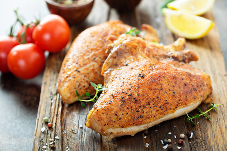 Grilled or smoked chicken breast with bone and skin Stockfoto