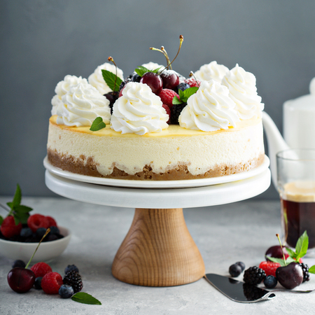 Classic New York cheesecake decorated with whipped cream Stock Photo - 105946681