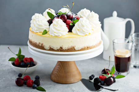 Classic New York cheesecake decorated with whipped cream