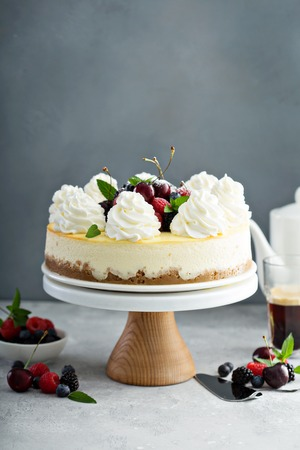 Classic New York cheesecake decorated with whipped cream Stock Photo - 105946687