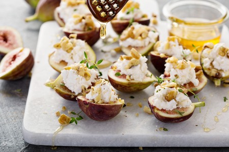 Fresh figs stuffed with ricotta and pine nuts Banco de Imagens