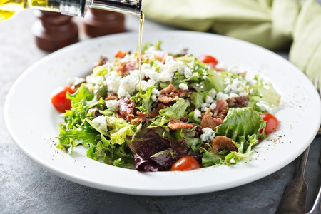 Green salad with blue cheese and bacon Stock Photo