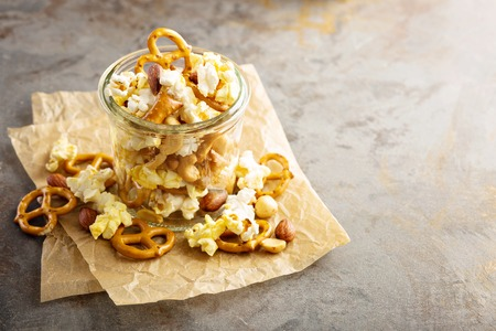 Trail mix with popcorn and pretzels Stock Photo