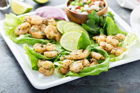 Spicy shrimp lettuce wraps with salsa