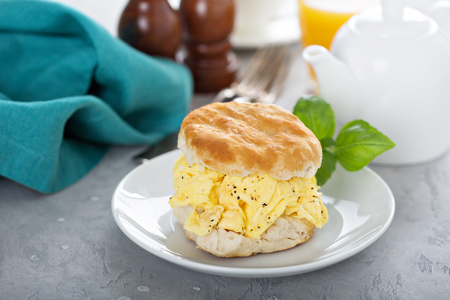 Breakfast biscuit with soft scrambled eggs Stock Photo