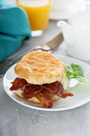 Breakfast biscuit with bacon Фото со стока