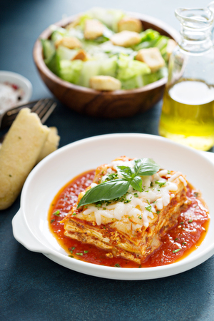 Traditional lasagna on white plate