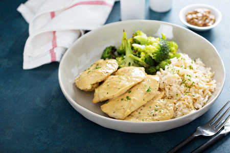 Mustard chicken with rice and broccoli Stock Photo