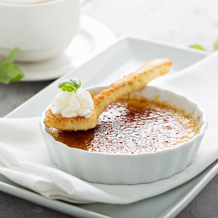 Creme brulee dessert with a cup of cappuccino Stock Photo - 110713026
