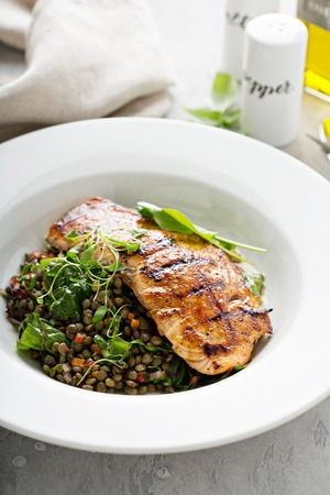 Grilled salmon with lentils and swiss chard