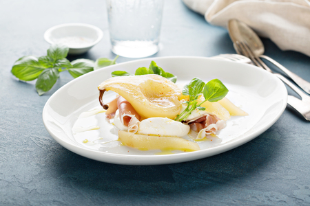 Poached pear with fresh cheese and proscuitto