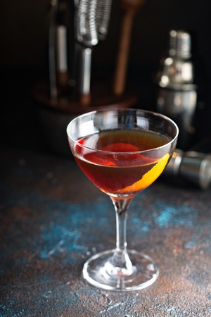 Fall whiskey cocktail with orange zest Stock Photo