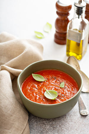 Tomato basil soup on the table.
