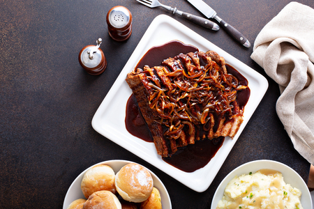 Sliced brisket with caramelized onions