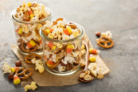 Homemade Halloween trail mix with candy corn, popcorn and pretzels
