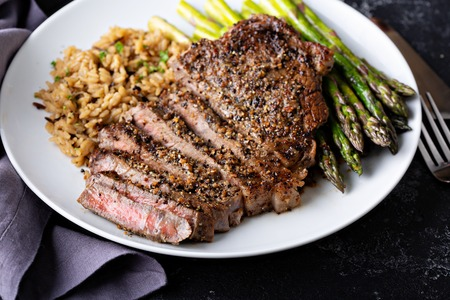 Delisious steak with rice and asparagus