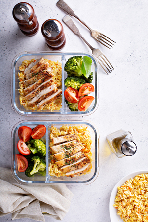Healthy meal prep containers with chicken, rice and vegetables Archivio Fotografico - 114550933