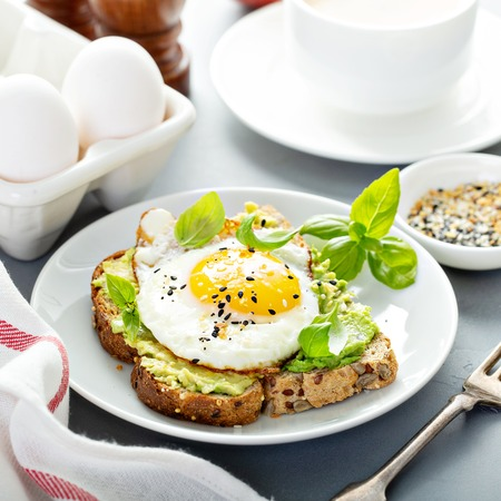 Avocado toast with fried egg Stok Fotoğraf