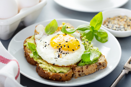 Avocado toast with fried egg Banco de Imagens